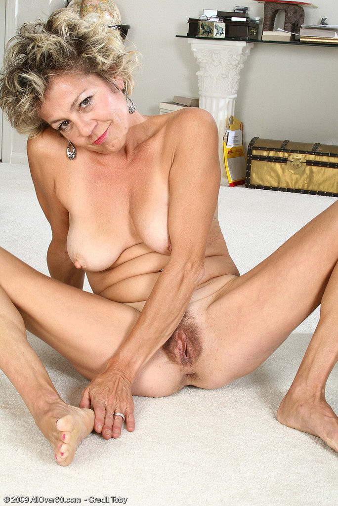 Another mature lady with a fat one 10